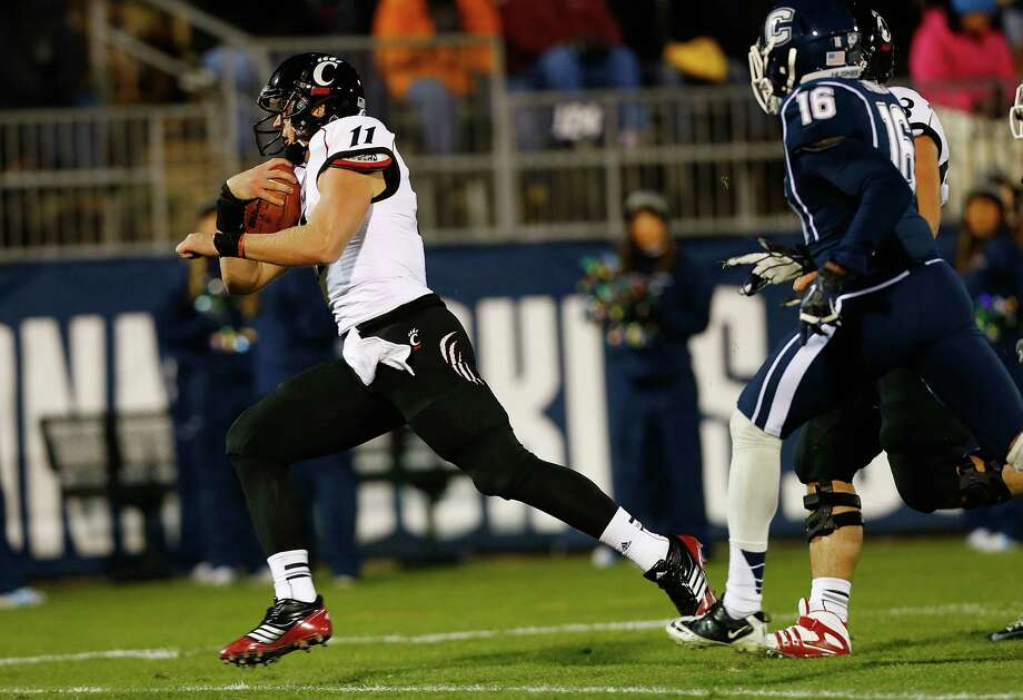 EAST HARTFORD, CT - DECEMBER 1: Brendon Kay #11 of the Cincinnati Bearcats scores a touchdown on a trick play in the first half against the Connecticut Huskies during the game at Rentschler Field on December 1, 2012 in East Hartford, Connecticut. (Photo by Jared Wickerham/Getty Images) Photo: Jared Wickerham, Getty Images / 2012 Getty Images