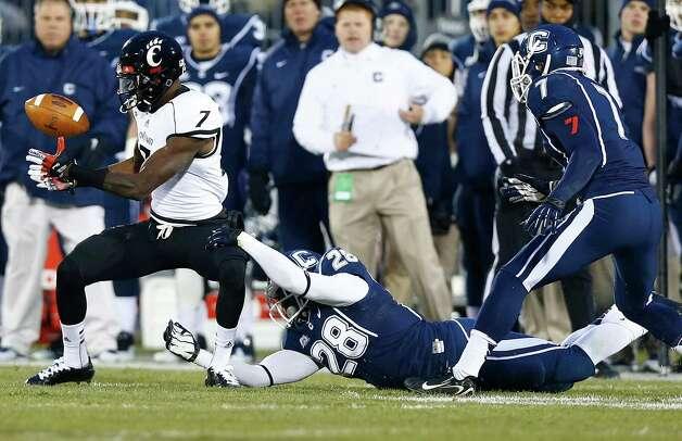 EAST HARTFORD, CT - DECEMBER 1: Kenbrell Thompkins #7 of the Cincinnati Bearcats fumbles the ball after catching a pass in front of Jory Johnson #28 of the Connecticut Huskies during the game at Rentschler Field on December 1, 2012 in East Hartford, Connecticut. (Photo by Jared Wickerham/Getty Images) Photo: Jared Wickerham, Getty Images / 2012 Getty Images