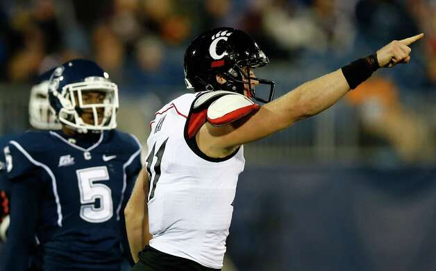 EAST HARTFORD, CT - DECEMBER 1: Brendon Kay #11 of the Cincinnati Bearcats celebrates after scoring a touchdown on a trick play in the first half against the Connecticut Huskies during the game at Rentschler Field on December 1, 2012 in East Hartford, Connecticut. (Photo by Jared Wickerham/Getty Images) Photo: Jared Wickerham, Getty Images / 2012 Getty Images