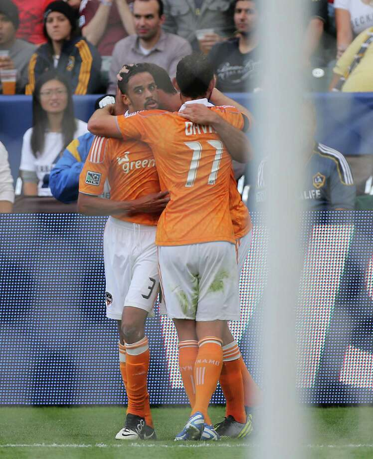 The Houston Dynamo's Calen Carr left, celebrates with teammate Brad Davis after Carr scored a goal against the Los Angeles Galexy during the first half of the 2012 MLS Cup championship game at the Home Depot Center Saturday, Dec. 1, 2012, in Los Angeles. Photo: James Nielsen, Chronicle / © Houston Chronicle 2012