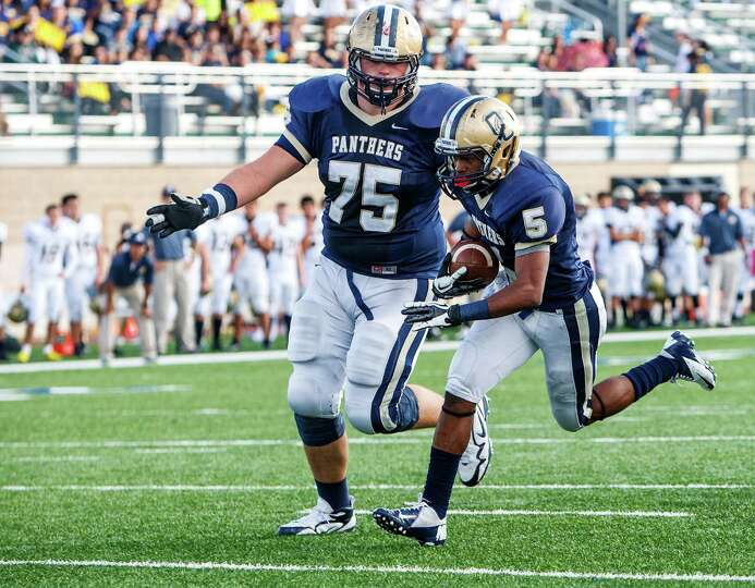 O'Connor's Baylen Brown (left) escorts Tre Johnson across the goal line for a touchdown during th