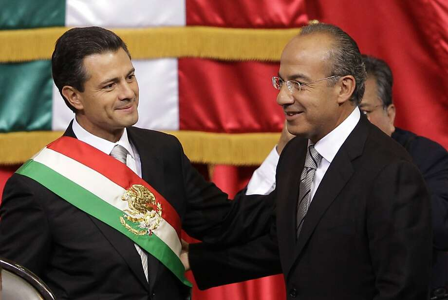Incoming President Enrique Pena Nieto (left) with ex-President Felipe Calderon during inauguration. Photo: Alexandre Meneghini, Associated Press