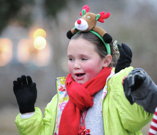 Sarah Boutelle, 9, of Cos Cob, wears a Rudolph the Red-Nosed Reindeer hair band during the first Winter's Eve Festival behind the Cos Cob Firehouse, Saturday, Dec. 1, 2012. Photo: Bob Luckey / Greenwich Time