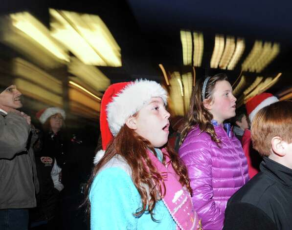 Cos Cob School Chorus member, Maddie Bassalik, 10, center, sings during the first Winter's Eve Festival behind the Cos Cob Firehouse, Saturday, Dec. 1, 2012. Photo: Bob Luckey / Greenwich Time
