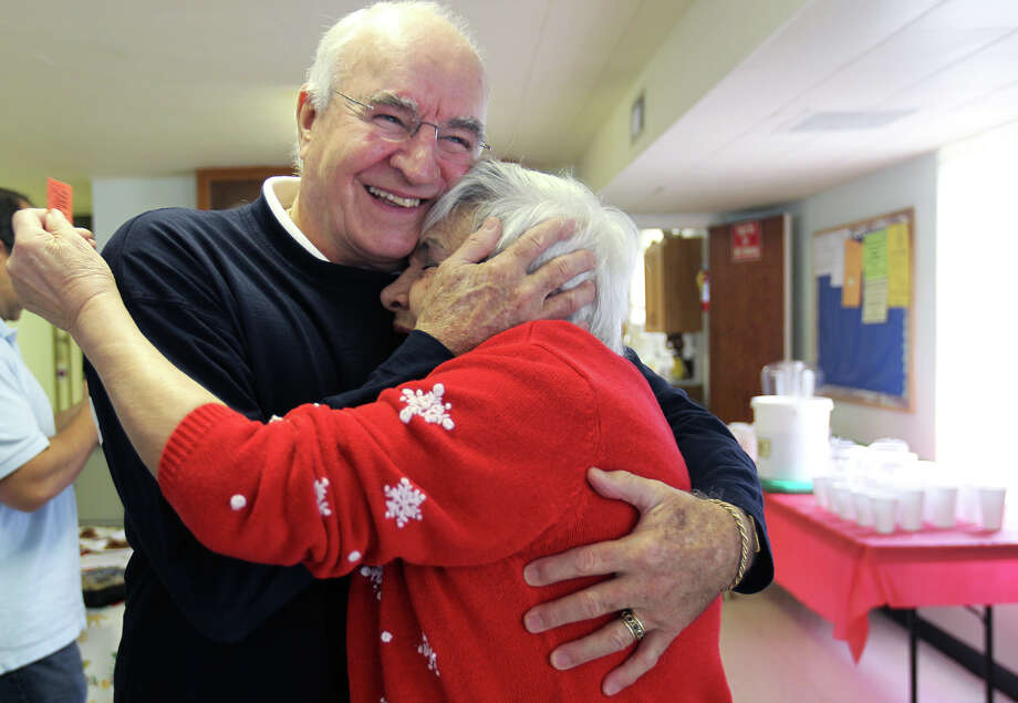 Jerry Craft greets Antoinette Mazzio who worked at Joske's for 34 years as members of the Joske's Quarter Century Club had their final meeting at Trinity Lutheran Church, Saturday, December 1, 2012. The club is made up of former employees of Joske's Department Store, the iconic downtown retailer that closed in 1987 and whose building is still vacant. Photo: JENNIFER WHITNEY / © Jennifer Whitney
