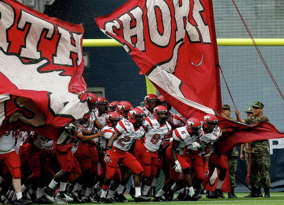 North Shore Mustangs take the field during a Class 5A Division I playoff game. Photo: Bob Levey, Houston Chronicle / ©2012 Bob Levey