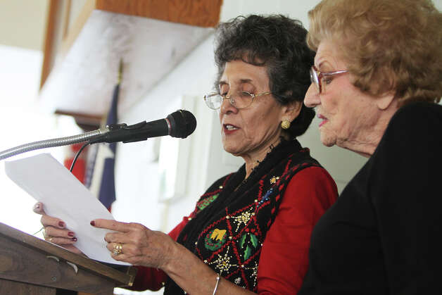 Margie R. Gonzales, secretary, and Mary Ann Pintaric, club president, read off the names of the members of the club as members of the Joske's Quarter Century Club had their final meeting at Trinity Lutheran Church, Saturday, December 1, 2012. The club is made up of former employees of Joske's Department Store, the iconic downtown retailer that closed in 1987 and whose building is still vacant. Photo: JENNIFER WHITNEY / © Jennifer Whitney