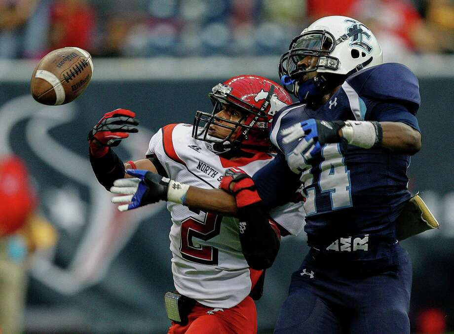 North Shore's Kevian DeLeon has a pass just go off his fingertips as he is defended by D'Errix Gray. Photo: Bob Levey, Houston Chronicle / ©2012 Bob Levey