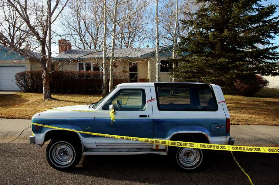 Crime scene tape surrounds the home of Casper College instructors James Krumm, 56, and Heidi Arnold, 42, who were slain Friday by Krumm's 25-year-old son, Christopher Krumm, who killed himself, too. No motive was immediately known. Photo: Alan Rogers, Associated Press / Casper Star-Tribune