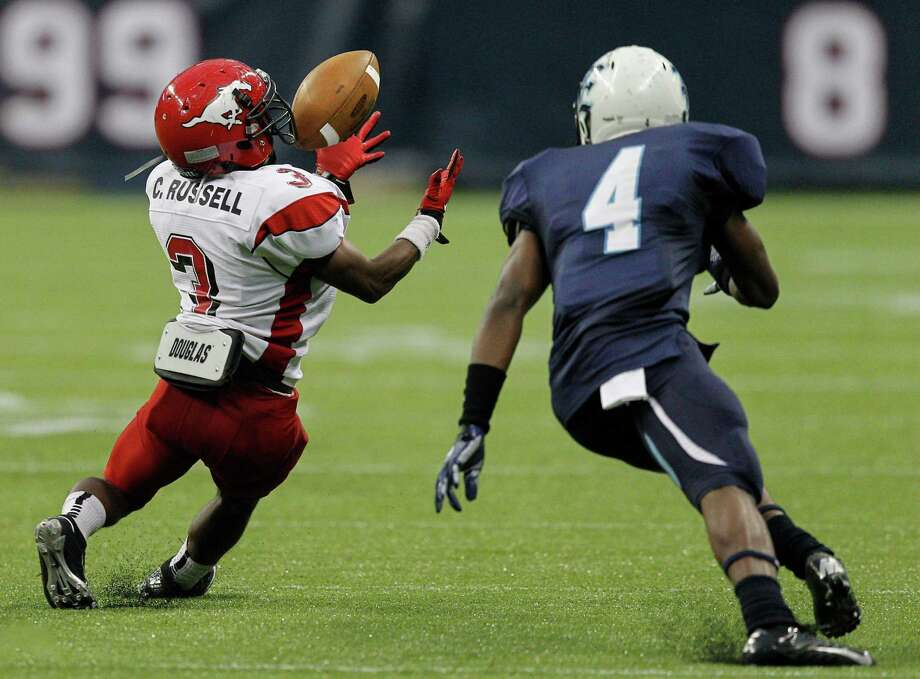 North Shore's Chris Russell intercepts a pass intended for Elsik's Casey Williams. Photo: Bob Levey, Houston Chronicle / ©2012 Bob Levey