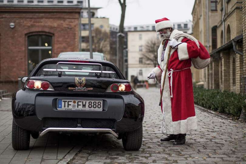 A man dressed as Santa, leaves the meeting where students gathered for their annual pre-Christmas ga