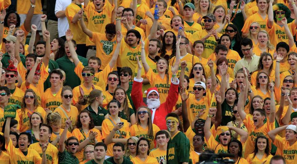 Baylor fans, including one dressed as Santa Claus, cheer during the first half of an NCAA college fo
