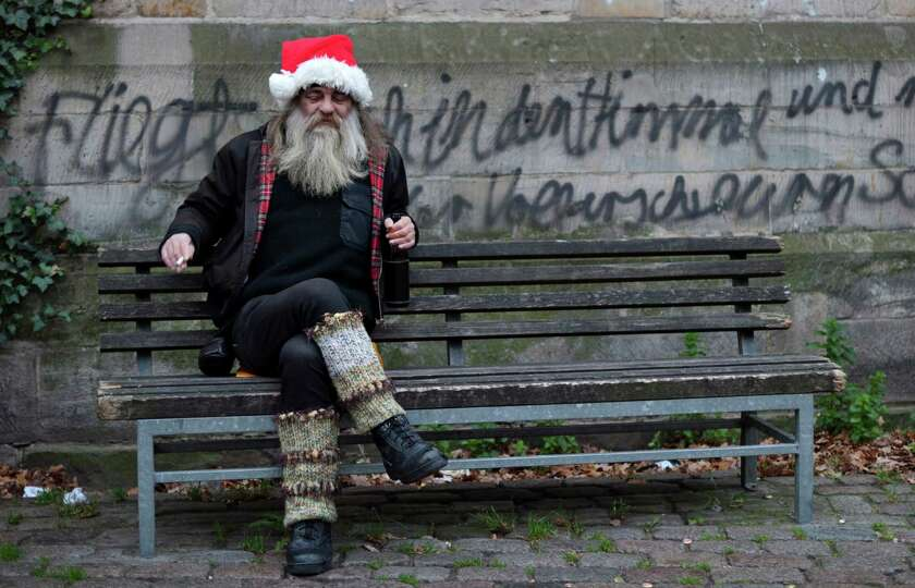 'Jingle bell' Rolf sits at a bench on November 29, 2012 in front of a Lutheran Church in Hanover, ea