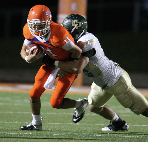 Sam Houston State quarterback Brian Bell (left) is sacked by Cal Poly's Chris Nicholls during the se