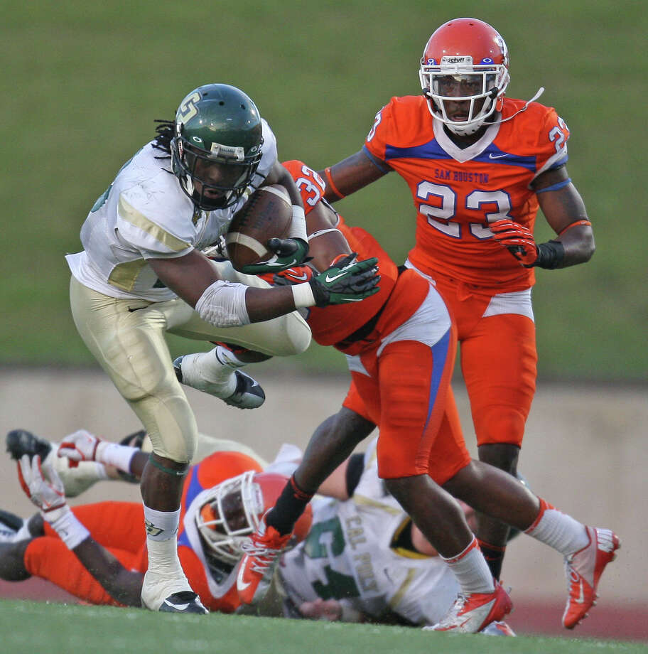 Cal Poly's Deonte Williams (left) is tackled by Sam Houston State's Kenneth Jenkins during the second half of a FCS college football playoff game, Saturday, December 1, 2012 at Bowers Stadium in Huntsville, TX. Photo: Eric Christian Smith, For The Chronicle