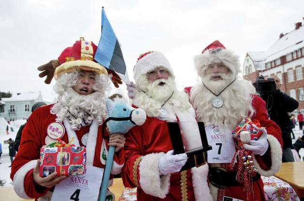 "Winner of Santa Claus Winter Games, Dutch Santa Claus ""Santa Holland"" (C), second placed ""Santa Rainbow"" from Hong Kong and third place Estonian Santa Claus ""Santa Aare"" pose in Gallivare, above the polar circle in northern Sweden on November 17, 2012. Santas from all over the world gather this weekend for the Santa Claus Winter Games where they will practice ""Reindeer""-ride, Porridge-eating, Santa-Karaoke, Kicksled Sack Race and Santas Christmas-eve. Photo: JONATHAN NACKSTRAND, AFP/Getty Images / AFP"