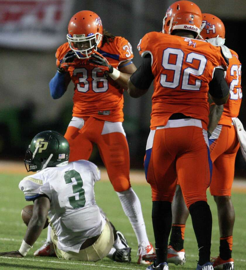 Sam Houston State's Darnell Taylor (398) taunts Cal Poly quarterback Andre Broadus after Taylor's sack during the second half of a FCS college football playoff game, Saturday, December 1, 2012 at Bowers Stadium in Huntsville, TX. Photo: Eric Christian Smith, For The Chronicle