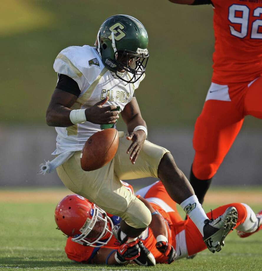 Cal Poly quarterback Andre Broadous (3) fumbles after being tackled by Sam Houston State safety Darnell Taylor during the first half of a FCS college football playoff game, Saturday, December 1, 2012 at Bowers Stadium in Huntsville, TX. Photo: Eric Christian Smith, For The Chronicle