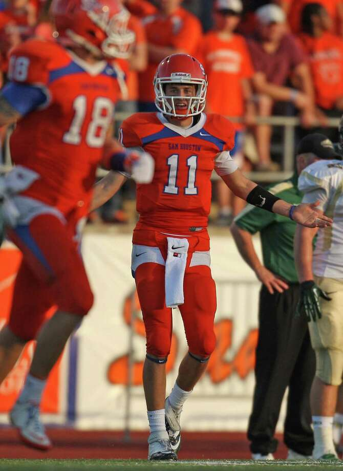 Sam Houston State quarterback Brian Bell (11) yells at teammate Trey Diller (18) during the first half of a FCS college football playoff game against Cal Poly, Saturday, December 1, 2012 at Bowers Stadium in Huntsville, TX. Photo: Eric Christian Smith, For The Chronicle