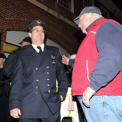 At left, Lt. John Chimblo of the Greenwich Fire Department speaks with Greenwich Emergency Management Director Dan Warzoha during an Old Greenwich Community appreciation ceremony to thank first responders and emergency personnel for their work before, during and after Hurricane Sandy, at the Sound Beach Firehouse, Saturday night, Dec. 1, 2012. Chimblo and four other Greenwich firefighters were the first to arrive on the scene of a house fire at 45 Binney Lane in Old Greenwich during the height of Hurricane Sandy and are credited with extinguishing the resulting fires that could have destoryed an entire neighborhood. Photo: Bob Luckey / Greenwich Time