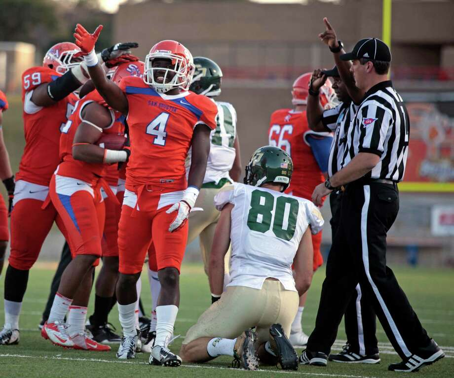 Sam Houston State's Ryan Wilson (4) signals possession after the Bearkats recovered a fumble by Cal Poly's Josh Swaney (80) during the first half of a FCS college football playoff game, Saturday, December 1, 2012 at Bowers Stadium in Huntsville, TX. Photo: Eric Christian Smith, For The Chronicle