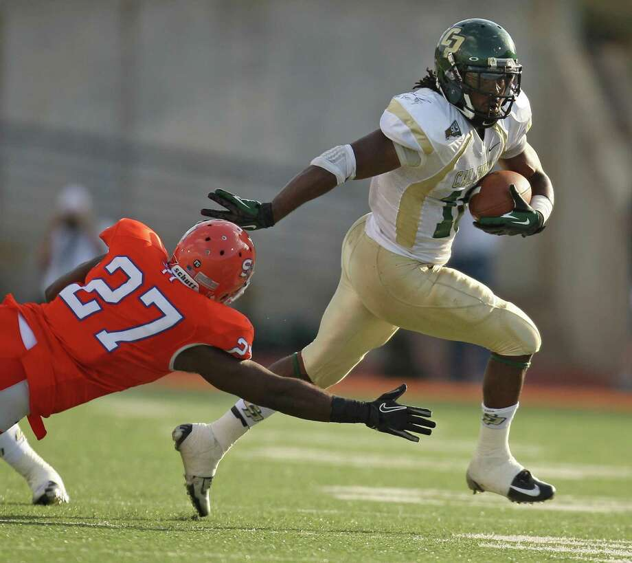 Cal Poly's Deonte Williams (right) scampers past Sam Houston State's Mike LIttleton during the first half of a FCS college football playoff game, Saturday, December 1, 2012 at Bowers Stadium in Huntsville, TX. Photo: Eric Christian Smith, For The Chronicle