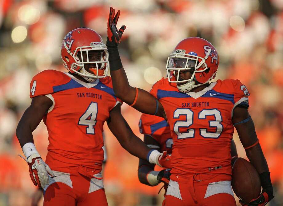 Sam Houston State safety Robert Shaw (23) celebrates his interception with teammate Ryan Wilson during the first half of a FCS college football playoff game against Cal Poly, Saturday, December 1, 2012 at Bowers Stadium in Huntsville, TX. Photo: Eric Christian Smith, For The Chronicle