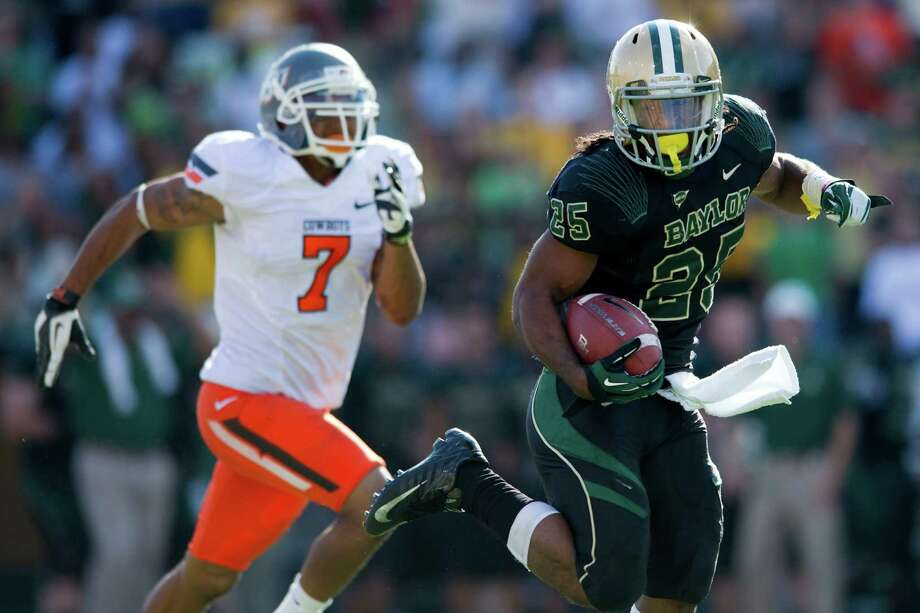 WACO, TX - DECEMBER 1: Lache Seastrunk #25 of the Baylor University Bears breaks free for a 76 yard touchdown run against the Oklahoma State University Cowboys on December 1, 2012 at Floyd Casey Stadium in Waco, Texas. Photo: Cooper Neill, Getty Images / 2012 Getty Images