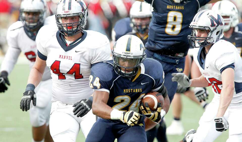 Cy Ranch 43, Manvel 42Cypress Ranch Mustangs running back Kewai Wilder rushes against the