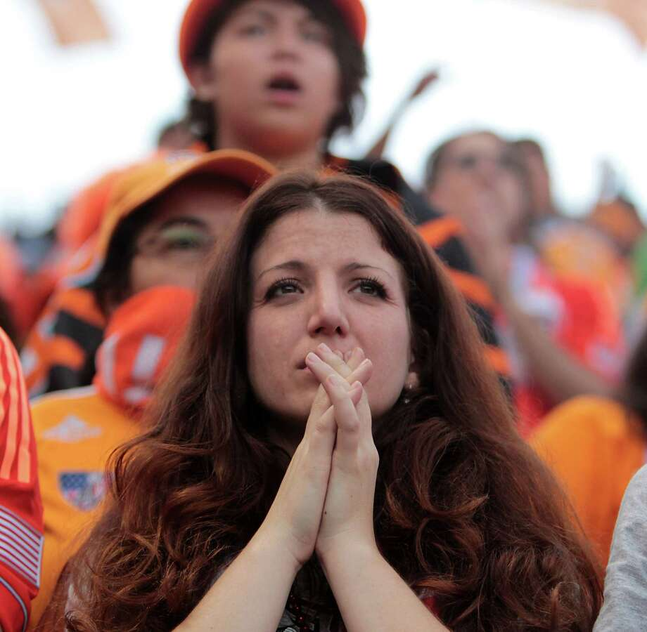 Houston Dynamo fan Julie Puccio watches the game during the second half of the 2012 MLS Cup championship game between the Los Angeles Galexy and the Houston Dynamo at the Home Depot Center Saturday, Dec. 1, 2012, in Los Angeles. Photo: James Nielsen, Chronicle / © Houston Chronicle 2012