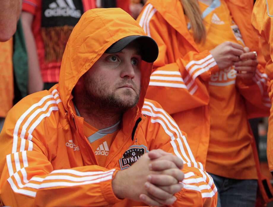 Houston Dynamo fan Kaleb Shamblih watches the game during the second half of the 2012 MLS Cup championship game between the Los Angeles Galexy and the Houston Dynamo at the Home Depot Center Saturday, Dec. 1, 2012, in Los Angeles. Photo: James Nielsen, Chronicle / © Houston Chronicle 2012