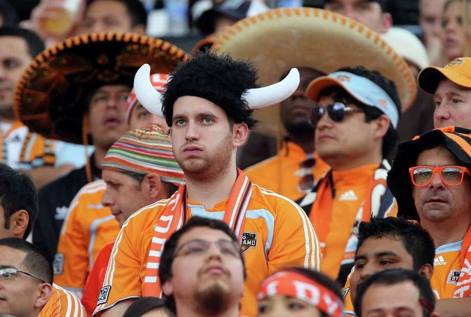 Houston Dynamo fan Michael Sherfield center, watches the game during the second half of the 2012 MLS Cup championship game betweeen the Los Angeles Galexy and the Houston Dynamo at the Home Depot Center Saturday, Dec. 1, 2012, in Los Angeles. Photo: James Nielsen, Chronicle / © Houston Chronicle 2012