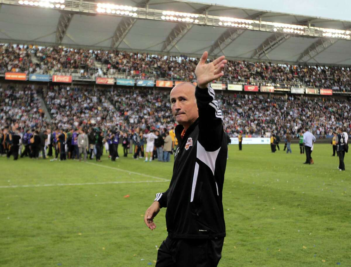 The Houston Dynamo's coach Dominic Kinnear walks on the field after the Dynamo were defeated in the 2012 MLS Cup championship game by the Los Angeles Galexy at the Home Depot Center Saturday, Dec. 1, 2012, in Los Angeles.