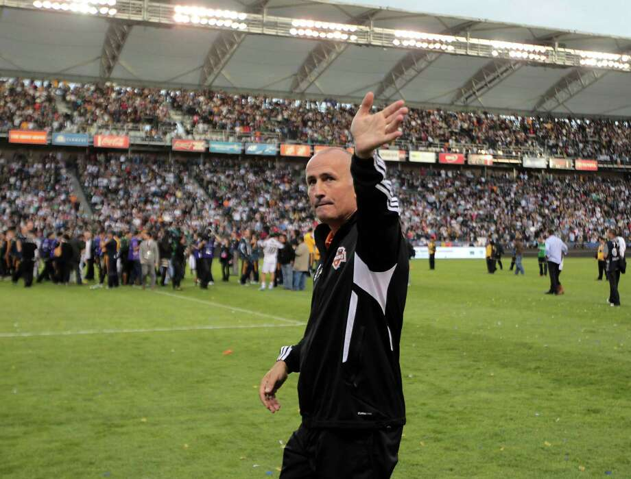 The Houston Dynamo's coach Dominic Kinnear walks on the field after the Dynamo were defeated in the 2012 MLS Cup championship game by the Los Angeles Galexy at the Home Depot Center Saturday, Dec. 1, 2012, in Los Angeles. Photo: James Nielsen, Chronicle / © Houston Chronicle 2012