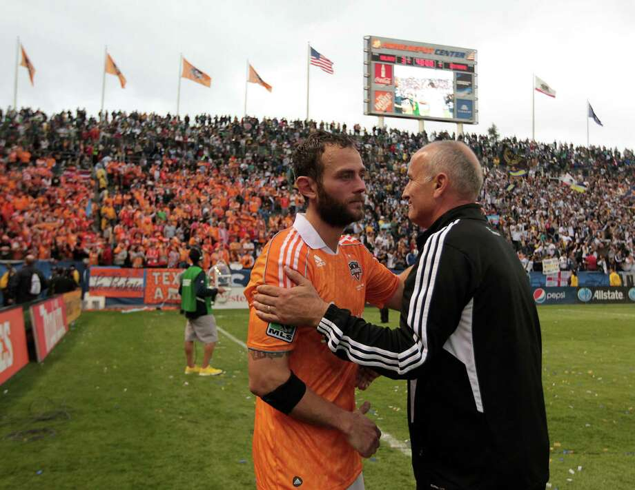 The Houston Dynamo's coach Dominic Kinnear and Brad Davis on the field after the Dynamo were defeated in the 2012 MLS Cup championship game by the Los Angeles Galexy at the Home Depot Center Saturday, Dec. 1, 2012, in Los Angeles. Photo: James Nielsen, Chronicle / © Houston Chronicle 2012