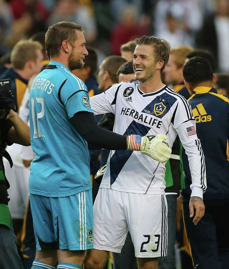 The Los Angeles Galaxy goalkeeper Josh Saunders left, and teammate David Beckham celebrate after defeating the Houston Dynamo in the 2012 MLS Cup championship game at the Home Depot Center Saturday, Dec. 1, 2012, in Los Angeles. Photo: James Nielsen, Chronicle / © Houston Chronicle 2012