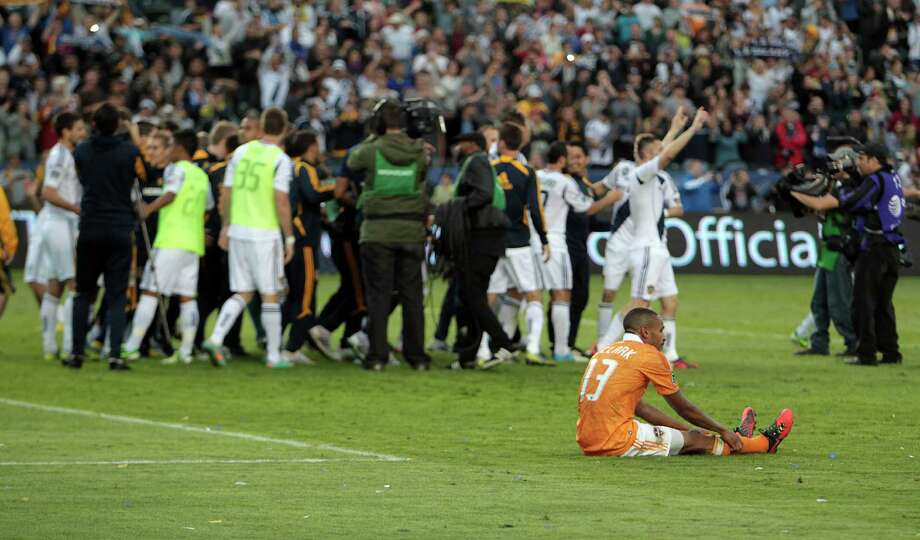 The Houston Dynamo Ricardo Clark sits on the field after the Dynamo were defeated in the 2012 MLS Cup championship game by the Los Angeles Galexy at the Home Depot Center Saturday, Dec. 1, 2012, in Los Angeles. Photo: James Nielsen, Chronicle / © Houston Chronicle 2012