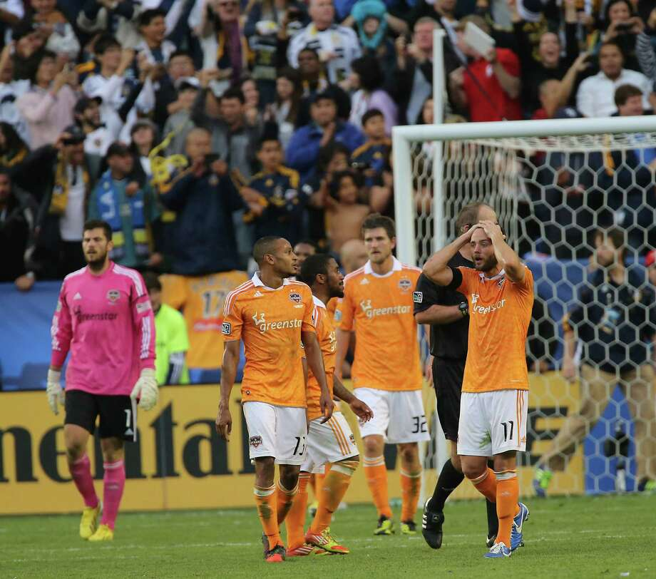 Houston Dynamo  players walk on the field after The Los Angeles Galaxy defeated the Dynamo in the 2012 MLS Cup championship game at the Home Depot Center Saturday, Dec. 1, 2012, in Los Angeles. Photo: James Nielsen, Chronicle / © Houston Chronicle 2012