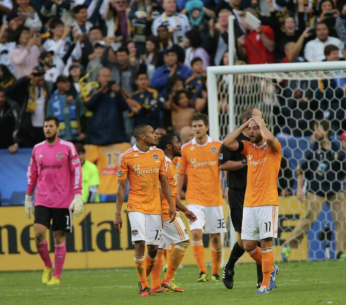 Houston Dynamo  players walk on the field after The Los Angeles Galaxy defeated the Dynamo in the 20