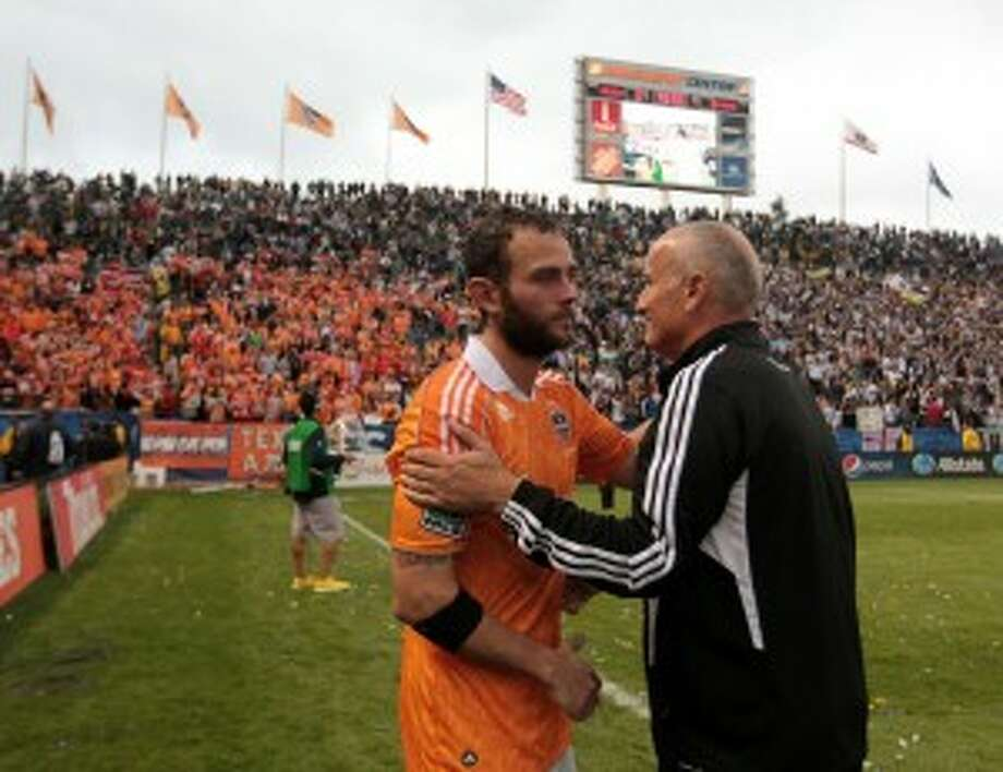After back-to-back MLS Cup losses, Dominic Kinnear, right, and Brad Davis hope to return to the title game and win it this season.