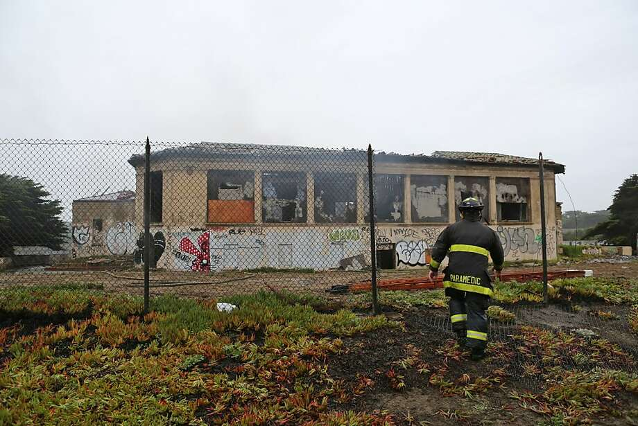 A firefighter collects gear outside the historic bathhouse for the Fleishhacker Pool, which closed in 1971. The unused bathhouse had fallen into disrepair. Photo: Rashad Sisemore, The Chronicle