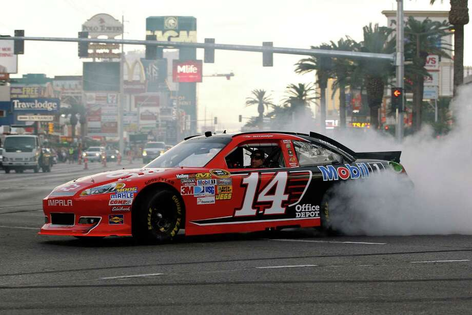 LAS VEGAS, NV - NOVEMBER 29:  Tony Stewart, driver of the #14 Office Depot Chevrolet, performs a burnout during the NASCAR Victory Lap on the Las Vegas Strip on November 29, 2012 in Las Vegas, Nevada.  (Photo by Tom Pennington/Getty Images for NASCAR) Photo: Tom Pennington