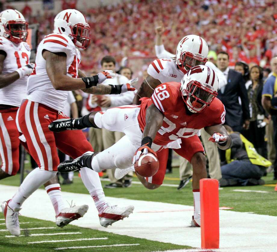 Wisconsin running back Montee Ball (28) dives into the end zone of a touchdown during the first half of the Big Ten championship NCAA college football game against Nebraska on Saturday, Dec. 1, 2012, in Indianapolis. (AP Photo/AJ Mast) Photo: AJ Mast, Associated Press / FR123854 AP