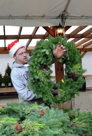 James Shanley, of Frogtown Farms in New Canaan, lays out wreaths for sale at the SoNo Market Place, an indoor European style market located at 314 Wilson Avenue in Norwalk on Saturday, Dec. 1, 2012. Photo: Amy Mortensen / Connecticut Post Freelance