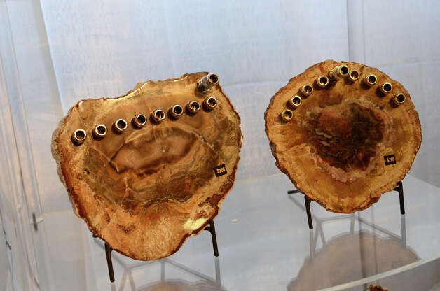 Petrified wood menorahs designed by Susan Lowenthal, of By Susan Designs, are on display at the SoNo Market Place, an indoor European style market located at 314 Wilson Avenue in Norwalk on Saturday, Dec. 1, 2012. Lowenthal is a mixed media artist who incorporates petrified wood, agate, and stones into her work. Photo: Amy Mortensen / Connecticut Post Freelance