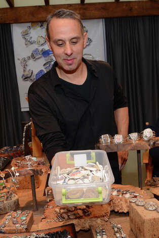 Tommy Conch, of Tommy Conch, LLC, shows the raw materials he works with at the SoNo Market Place, an indoor European style market located at 314 Wilson Avenue in Norwalk on Saturday, Dec. 1, 2012. Conch repurposes vintage pieces, such as broken porcelain, and sets them in solid sterling silver. Photo: Amy Mortensen / Connecticut Post Freelance