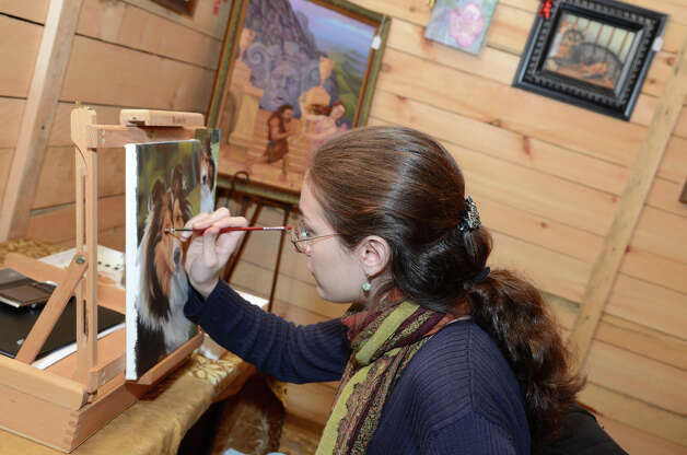Annalisa Schaefer, of Art by Annalisa, creates a pet portrait in her space at the SoNo Market Place, an indoor European style market located at 314 Wilson Avenue in Norwalk on Saturday, Dec. 1, 2012. Photo: Amy Mortensen / Connecticut Post Freelance