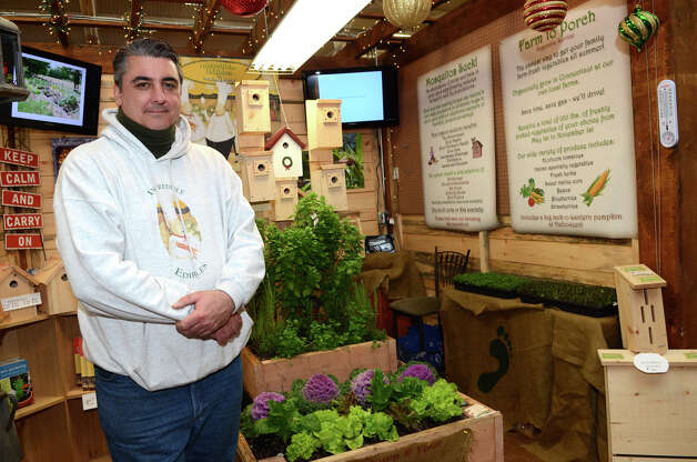 Mike Sette, of Incredible Edibles, stands in his booth at the SoNo Market Place, an indoor European style market located at 314 Wilson Avenue in Norwalk on Saturday, Dec. 1, 2012. Sette's service offers farm to porch vegetable programs and mosquito management. Photo: Amy Mortensen / Connecticut Post Freelance