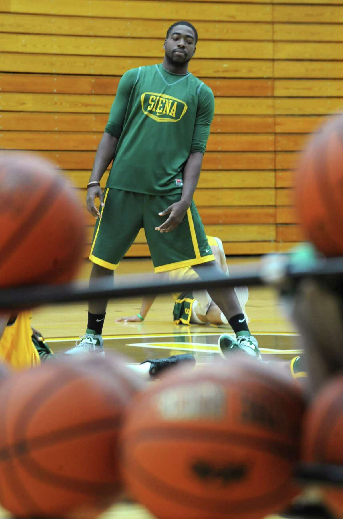 Siena basketball player O.D. Anosike stretches before practice on Tuesday Nov. 27, 2012 in Loudonville, N.Y. (Lori Van Buren / Times Union)