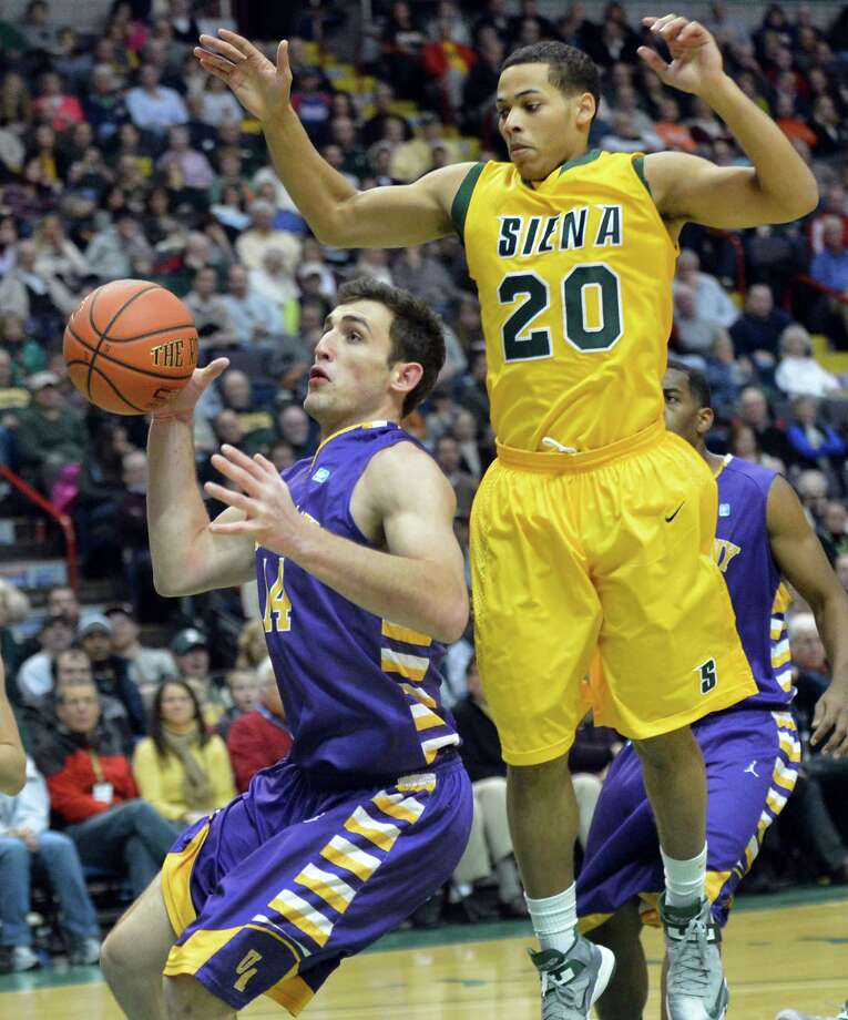 UAlbany's 14 Sam Rowley, left, and Siena's #20 Chris Leppanen during Saturdays game at the Times Union Center in Albany Dec. 1, 2012.  (John Carl D'Annibale / Times Union) Photo: John Carl D'Annibale / 00020104A